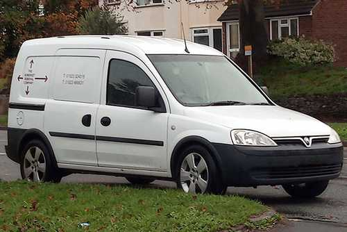 A small Somerset Removal Company van outside someones house ready to load