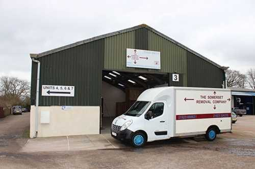 Long angle view of a large Somerset Removal Company van outside their warehouse