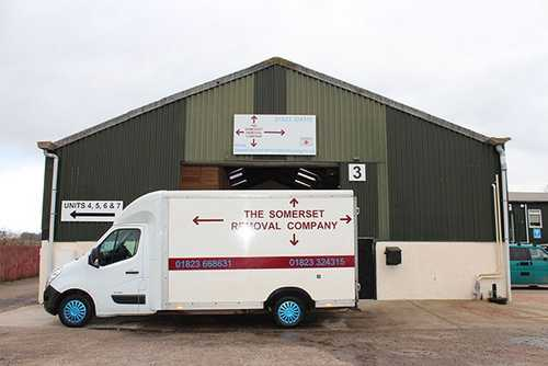 Straight on view of the Somerset Removal Company large van outside the warehouse